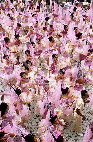 Rio de Janeiro, Brazil. Bloco Espanhol; samba school carnival parade; pink dresses and fans.
