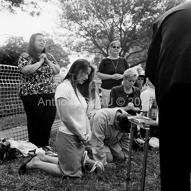 Pinellas Park, Florida<br /> March 24, 2005<br /> <br /> Right-wing religious-groups hoping to save the life of Terri Schiavo, a seven-year brain-damaged patient inside the hospital, gather outside to pray. The U.S. Supreme Court rejected a plea from her parents to restart her feeding, leaving them nearly out of options and time in the legal fight for their daughter's life.