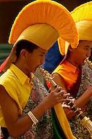 Yellow Hat Buddhist Lama Monks playing pipes in a Losar procession, Sikkim, India