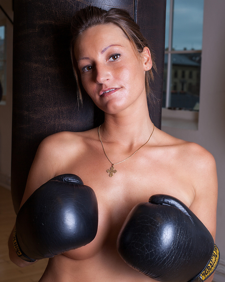 Young danish woman showing off her body in the boxing gym.