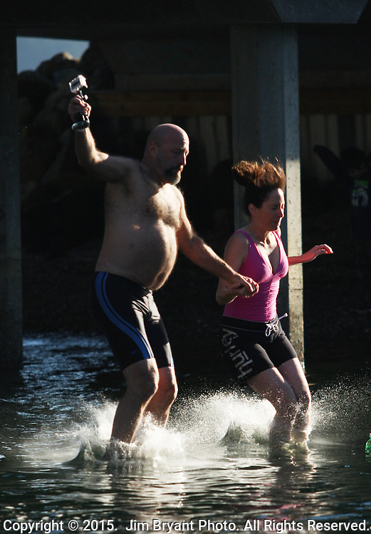 Two jumpers record themselves hitting the Burley Lagoon during the 31st annual Polar Bear on January 1, 2015 in Olalla, Washington. Over 500 hardy participants joined in on the annual New Year's Day Tradition by jumping into the chilly lagoon waters during the annual Polar Bear Plunge.  ©2015.  Jim Bryant Photo. All Rights Reserved.