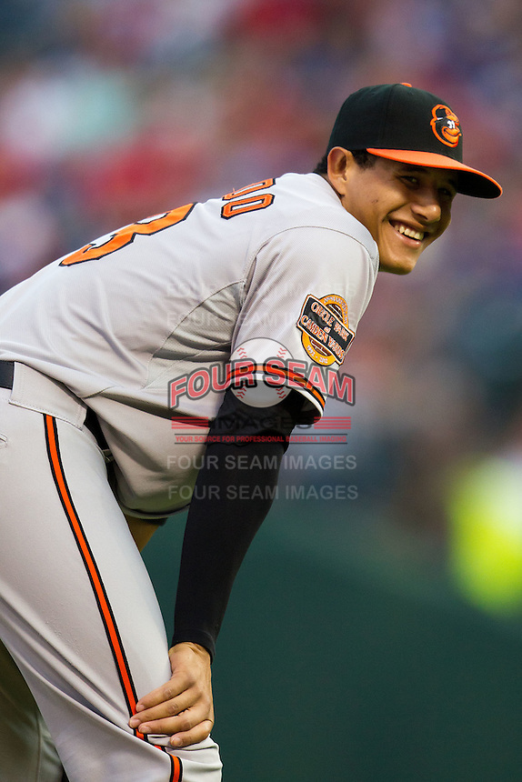Baltimore Orioles third baseman Manny Machado #13 smiles at his dugout during the Major League Baseball game against the Texas Rangers on August 21st, 2012 at the Rangers Ballpark in Arlington, Texas. The Orioles defeated the Rangers 5-3. (Andrew Woolley/Four Seam Images).