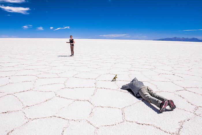 Taking perspective photos at Uyuni Salt Flats (Salar de Uyuni), Uyuni, Bolivia