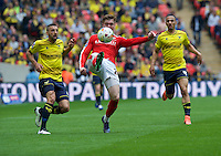 Alfie Mawson of Barnsley kicks the ball clear from Liam Sercombe of Oxford United during the Johnstone's Paint Trophy Final match between Oxford United and Barnsley at Wembley Stadium, London, England on 3 April 2016. Photo by Alan  Stanford / PRiME Media Images.