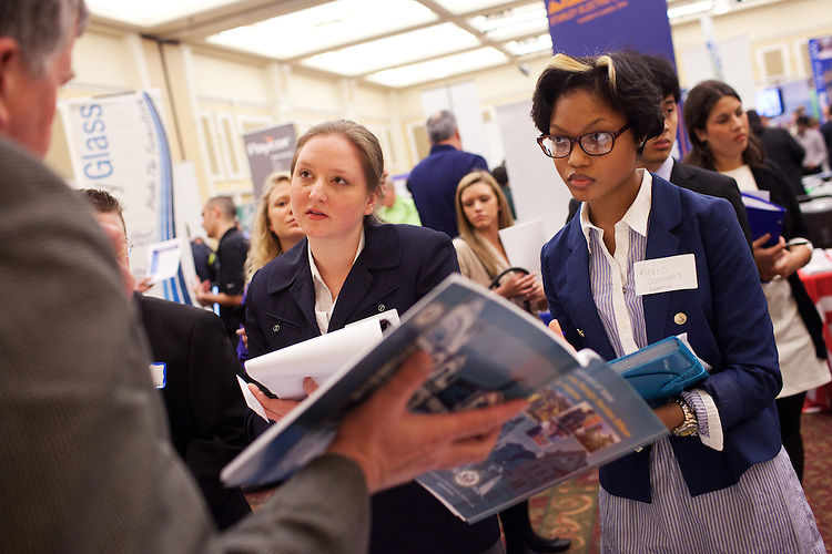 Alexis Chambers (right) and Andreya Carlson visit with an organization about possible full-time positions and internships opportunities at the Spring Career & Internship Fair in the Baker Center in Athens, Ohio on Tuesday, February 19, 2013. Photo by Chris Franz