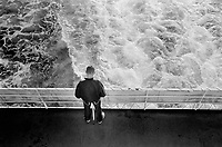 Albania. Province of Durres. Durres. A young man looks at the Mediterranean sea from the back of a steam ship. 30.09.03 © 2003 Didier Ruef