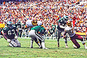 Philadelphia Eagles quarterback Ron Jaworski (7) is sacked by Washington Redskins left defensive tackle Dave Butz (65) during the game at RFK Stadium in Washington, DC  on September 7, 1986.   Eagles defending on the play include right guard Ron Baker (63) and right tackle Leonard Mitchell (74).  Watching in the background is wide receiver Mike Quick (82).  Also rushing Jaworski for the Redskins is left defensive end Charles Mann (71).  The Redskins won the game 41 - 14. <br /> Credit: Arnie Sachs / CNP