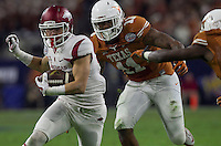 Arkansas Democrat-Gazette/BENJAMIN KRAIN --12/29/14--<br /> Arkansas receiver Drew Morgan is chased down near the goal line by Texas defender Tevin Jackson in the 2nd quarter in the Texas Bowl Monday night at NRG Stadium in Houston.