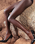 Closeup of sexy african american woman legs wearing black high heel stiletto shoes artistic fashion photo