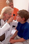 Pediatrician examines young boy
