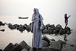 woman poses for a picture at the point of entrance to the Sunderbans in bangladesh, April 2014