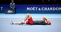 Alexander Zverev collapses to the floor after winning 2018 ATP World Tour Finals<br /> <br /> Photographer Hannah Fountain/CameraSport<br /> <br /> International Tennis - Nitto ATP World Tour Finals Day 7 - O2 Arena - London - Saturday 17th November 2018<br /> <br /> World Copyright &copy; 2018 CameraSport. All rights reserved. 43 Linden Ave. Countesthorpe. Leicester. England. LE8 5PG - Tel: +44 (0) 116 277 4147 - admin@camerasport.com - www.camerasport.com