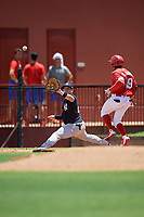 GCL Yankees East first baseman Jhoiner Rodriguez (29) stretches for a throw as Juan Carlos Smith (19) runs through the bag during a Gulf Coast League game against the GCL Phillies West on August 3, 2019 at the Carpenter Complex in Clearwater, Florida.  The GCL Yankees East defeated the GCL Phillies West 4-0, the second game of a doubleheader.  (Mike Janes/Four Seam Images)