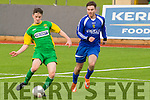 Feral Maunsell, KDL gives a careful instep pass with Leinsters Ian Twomey applying pressure when the sides met at Mounthawk Park, Tralee last Sunday evening.