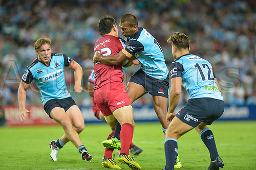 27.02.2016.  Sydney, Australia. Super Rugby. NSW Waratahs versus Queensland Reds. Reds Ayumu Goromaru is tackled by Waratahs centre Kurtley Beale. The Waratahs won 30-10.