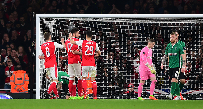 Arsenal's Olivier Giroud celebrates scoring his sides second goal <br /> <br /> Photographer Andrew Vaughan/CameraSport<br /> <br /> The Emirates FA Cup Quarter-Final - Arsenal v Lincoln City - Saturday 11th March 2017 - The Emirates - London<br />  <br /> World Copyright &copy; 2017 CameraSport. All rights reserved. 43 Linden Ave. Countesthorpe. Leicester. England. LE8 5PG - Tel: +44 (0) 116 277 4147 - admin@camerasport.com - www.camerasport.com