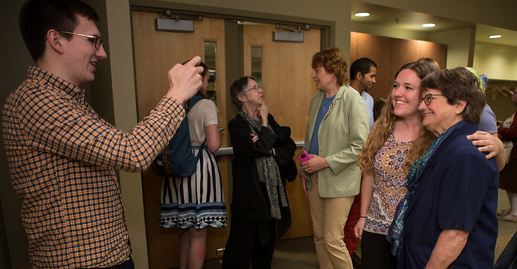 """Students pose for photos with author and anti-death penalty crusader Sister Helen Prejean, C.S.J., during a breakfast Wednesday, April 19, 2017, at DePaul University's Lincoln Park Campus. Prejean is the author of the widely acclaimed book """"Dead Man Walking"""" and is known for her work as an educator about the death penalty and counselor for death row inmates.The event was hosted by the Department of Catholic Studies. (DePaul University/Jeff Carrion)"""