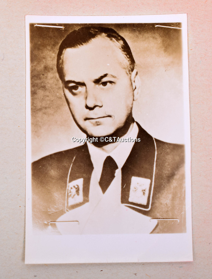 BNPS.co.uk (01202 558833)<br /> Pic: C&TAuctions/BNPS<br /> <br /> Alfred Rosenberg was the influential ideologue of the Nazi Party. He is considered one of the main authors of key National Socialist ideological creeds, including its racial theory, persecution of the Jews and opposition to degenerate modern art. At Nuremberg he was sentenced to death and executed by hanging for war crimes and crimes against humanity.<br /> <br /> A unique album of mugshots and signatures that helped bring scores of Nazi war criminals to justice has been unearthed more than 70 years later.<br /> <br /> The gallery that is like a Who's Who of Hitler's henchmen involved in the Holocaust was assembled by an Allied intelligence officer whose job was to interrogate the monsters.<br /> <br /> A vital part of the questioning was to get them to provide an authentic signature to compare it with handwriting of Nazi officials who signed off orders for war atrocities.<br /> <br /> The album is being sold at C&T Auctioneers of Ashford, Kent, on September 7.