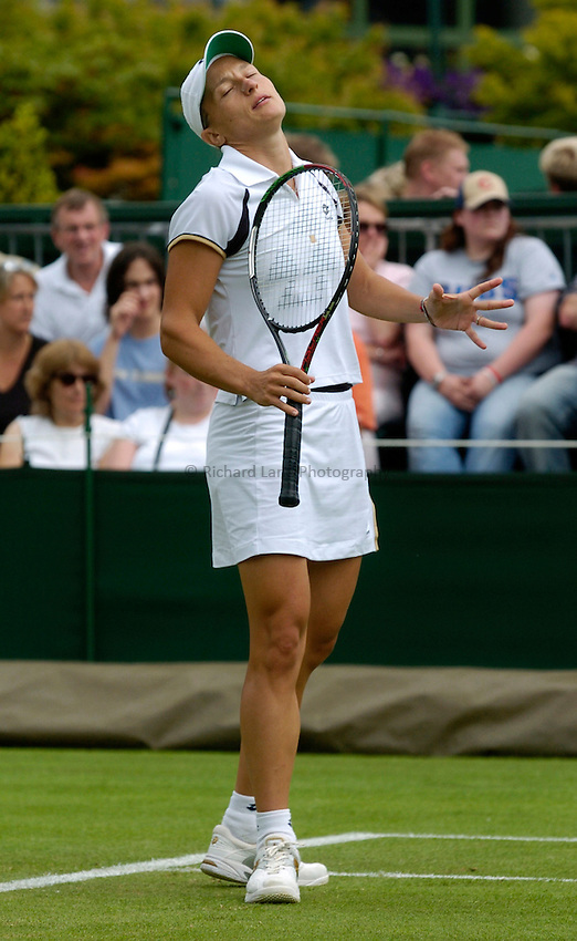Photo: Richard Lane..Wimbledon Championships. 27/06/2006..Italy's Tathiana Garbi shows her frustration.