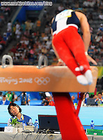 Aug. 9, 2008; Beijing, CHINA; An official appears to sleep as Jonathan Horton (USA) performs on the pommel horse during mens gymnastics qualification during the Olympics at the National Indoor Stadium. Mandatory Credit: Mark J. Rebilas-US PRESSWIRE