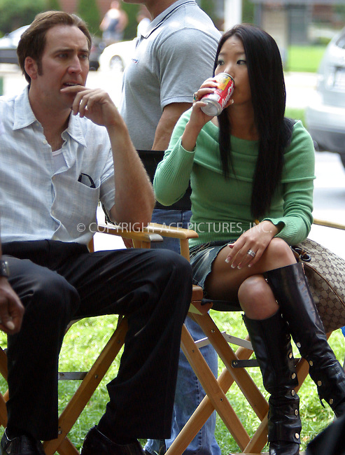Actor Nicolas Cage chats with his new bride 20 year old ex-sushi waitress Alice Kim on the set of his new movie 'Lord of War' in which he plays an arms dealer. The scene was shot at a Jewish Temple in Brighton Beach, Brooklyn, New York City. August 3 2004. Please byline: BRIAN FLANNERY/ACEPIXS.com..*PAY-PER-USE*....IMPORTANT: Please note that our old trade name New York Photo Press has changed to ACE Pictures. New York Photo Press and ACE Pictures are both owned by All Celebrity Entertainment, Inc.......All Celebrity Entertainment, Inc..Contact: Alecsey Boldeskul, (646) 267 6913..Philip vaughan, (646) 769 0430..e-mail: info@acepixs.com..Philip.Vaughan@acepixs.com