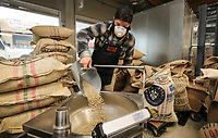 March 20, 2019. San Diego, CA. USA|  Brandt Rakowski measures green coffee beans to be roasted at Bird Rock Coffee Roasters off of Morena Blvd. in San Diego. | Photos by Jamie Scott Lytle. Copyright.