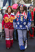 2 March 2014, Duesseldorf, Germany. Pictured: a couple in a hippy-style knitwear costume. Costumed carnival-goers enjoy the sunshine as they celebrate with a street party in Duesseldorf, North Rhine-Westphalia, Germany.
