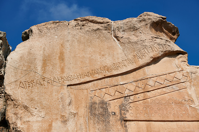 "Close up of the inscription dedicated to King Midas on the Phrygian rock Monument known locally as Yazilikaya, ( written rock ) . 8th - 6th century BC . Midas City, Yazilikaya, Eskisehir, Turkey.<br /> <br /> This is the largest Phrygian rock cut facade monument, measuring 17m x 16.5m. It represents the front of a Phrygian megaron type building with a low pitched roof. It is known locally as yazilikaya , which means ""written rock"", because of the Paleo-Phrygian inscriptions carved above the rock above the roof outline, down the right side and in the niche. The upper inscription dedicates the monument to King Midas, and so it is also known as the ""Midas Monument"". The niche probably contained an image of the Phrygian Mother  Goddess, and the word ""Matar"" (Mother) is inscribed inside. The monument was carved  around the 8th and  6th century BC."