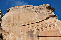 Close up of the inscription dedicated to King Midas on the Phrygian rock Monument known locally as Yazilikaya, ( written rock ) . 8th - 6th century BC . Midas City, Yazilikaya, Eskisehir, Turkey.<br /> <br /> This is the largest Phrygian rock cut facade monument, measuring 17m x 16.5m. It represents the front of a Phrygian megaron type building with a low pitched roof. It is known locally as yazilikaya , which means &ldquo;written rock&rdquo;, because of the Paleo-Phrygian inscriptions carved above the rock above the roof outline, down the right side and in the niche. The upper inscription dedicates the monument to King Midas, and so it is also known as the &ldquo;Midas Monument&rdquo;. The niche probably contained an image of the Phrygian Mother  Goddess, and the word &ldquo;Matar&rdquo; (Mother) is inscribed inside. The monument was carved  around the 8th and  6th century BC.