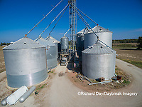 63801-08111 Farmer's grain bins and elevator- aerial Marion Co. IL