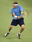 SHANGHAI, CHINA - OCTOBER 11:  Igor Andreev of Russia returns a shot against compatriot Igor Kunitsyn during day one of 2009 Shanghai ATP Masters 1000 at the Qi Zhong Tennis Centre in Shanghai. Photo by Victor Fraile / The Power of Sport Images