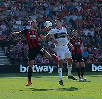 Both the captains clash as Bournemouth's Steve Cook (left) battles with Fulham's Aleksandar Mitrovic (right)<br /> <br /> Photographer David Horton/CameraSport<br /> <br /> The Premier League - Bournemouth v Fulham - Saturday 20th April 2019 - Vitality Stadium - Bournemouth<br /> <br /> World Copyright © 2019 CameraSport. All rights reserved. 43 Linden Ave. Countesthorpe. Leicester. England. LE8 5PG - Tel: +44 (0) 116 277 4147 - admin@camerasport.com - www.camerasport.com