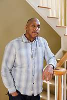 "FROM THE STORY: Claudiare Motley of Charlotte, North Carolina was shot in the jaw during an attempted carjacking in visiting Milwaukee for his high school reunion in June 2014. He learned about compensation from a liaison in the hospital and sent off his application about a month later. After his third surgery, his insurance carrier dropped him, leaving him truly desperate for financial aid. Wisconsin's compensation office told Motley he was eligible, but that he needed to wait to receive all his medical bills before they could determine a payout. Six months after he was shot, he graduated from law school. He read the victims compensation statute and learned about victims rights in Wisconsin. Between infections and surgeries to rebuild his jaw, he juggled phone calls with the hospital, the compensation office, the insurance company, and creditors. About two years after he applied for compensation, Wisconsin's compensation program paid $40,000 in medical bills to his doctor's office and hospital — the state's maximum award. Motley says the money was both a ""godsend"" and a ""drop in the bucket.""  As of early February 2018, Motley had undergone 10 surgeries and procedures. He currently owes more than $130,000 in medical expenses. Photographed at his home in Charlotte, NC Thursday, February 8, 2018. (Justin Cook for The Trace)"