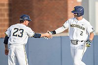 Michigan Wolverines outfielder Jonathan Engelmann (2) is congratulated by third base coach Nick Schnabel (23) after hitting a home run during the NCAA baseball game against the Eastern Michigan Eagles on May 16, 2017 at Ray Fisher Stadium in Ann Arbor, Michigan. Michigan defeated Eastern Michigan 12-4. (Andrew Woolley/Four Seam Images)