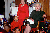 First lady Barbara Bush attends a Christmas Party for children at the Central Union Mission, a homeless shelter in Washington, DC, on December 13, 1989.<br /> Credit: Howard L. Sachs / CNP