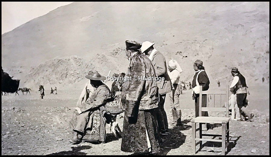 BNPS.co.uk (01202 558833)Pic: HAldridge/BNPS<br /> <br /> The Dalai Lama returning to Tibet in 1912.<br /> <br /> Game tales from the hills...remarkable album shows British attempts to win over newly invaded Tibet by playing sport's straight from the playing fields of England.<br /> <br /> A collection of photos have come to light which show the people of the remote Himalayan nation of Tibet embracing one of the traditional British pastimes - a sports day.<br /> <br /> The archive of more than 500 photos was collated by a British Lieutenant Colonel, R C MacGregor, of the Indian Medical Service, who was present in Tibet between 1904 and 1912.<br /> <br /> These photos are one of the earliest examples of the British attempting to win 'the hearts and minds' of a native population as they were taken during the controversial Younghusband expedition to the distant Buddhist country.<br /> <br /> The archive also features four never before seen photos of the Dalai Lama returning to Tibet in 1912 after his exile ended.