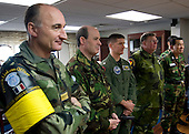 Military officials from the Neutral Nations Supervisory Commission are greeted in the in-port cabin Monday, November 29, 2010 before a tour of the aircraft carrier USS George Washington (CVN 73).  George Washington is in the waters west of the Korean peninsula preparing for a training exercise with the Republic of Korea Navy..Mandatory Credit: Marcus D. Mince - US Navy via CNP
