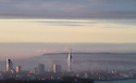 30/10/12 ..The dawn sunlight reflects off Portsmouth's Spinnaker Tower and turns the autumn mist pink looking across the The Solent towards the Isle of Wight. ..All Rights Reserved - F Stop Press.  www.fstoppress.com. Tel: +44 (0)1335 300098.