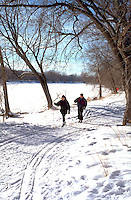 Couple age 32 cross country skiing by Crosby Lake. Crosby Park Nature Reserve St Paul  Minnesota USA