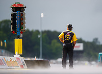 May 5, 2017; Commerce, GA, USA; Steam rises from the wet track surface as NHRA chief starter Mike Gittings looks on during a delay to qualifying for the Southern Nationals at Atlanta Dragway. Mandatory Credit: Mark J. Rebilas-USA TODAY Sports