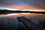 Idaho, South central, Camas County, Fairfield, A kids fishing pond in the pre-dawn light  reflecting in the calm water.