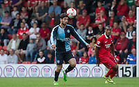 Joe Jacobson of Wycombe Wanderers heads clear of Jay Simpson of Leyton Orient during the Sky Bet League 2 match between Leyton Orient and Wycombe Wanderers at the Matchroom Stadium, London, England on 19 September 2015. Photo by Andy Rowland.