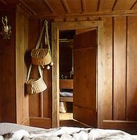 Fisherman's baskets hang next to the door to the ensuite bathroom