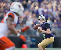 Jake Browning winds up to pass.