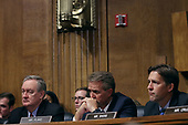 WASHINGTON, DC - SEPTEMBER 27:  Senate Judiciary Committee members (L-R) Sen. Mike Crapo (R-ID), Sen. Jeff Flake (R-AZ) (L) and Sen. Ben Sasse (R-NE) listen to testimony from Christine Blasey Ford in the Dirksen Senate Office Building on Capitol Hill September 27, 2018 in Washington, DC. A professor at Palo Alto University and a research psychologist at the Stanford University School of Medicine, Ford has accused Supreme Court nominee Judge Brett Kavanaugh of sexually assaulting her during a party in 1982 when they were high school students in suburban Maryland.  (Photo by Win McNamee/Getty Images)