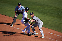 Glendale Desert Dogs third baseman Nicky Delmonico (23) waits for a pickoff attempt as Elliot Soto (2) gets back to the bag with umpire Roberto Ortiz looking on during an Arizona Fall League game against the Mesa Solar Sox on October 14, 2015 at Sloan Park in Mesa, Arizona.  Glendale defeated Mesa 7-6.  (Mike Janes/Four Seam Images)