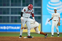 Brenden Dixon (1) of the Texas Longhorns holds a tag on Casey Opitz (12) of the Arkansas Razorbacks as he stands on second base in game six of the 2020 Shriners Hospitals for Children College Classic at Minute Maid Park on February 28, 2020 in Houston, Texas. The Longhorns defeated the Razorbacks 8-7. (Brian Westerholt/Four Seam Images)