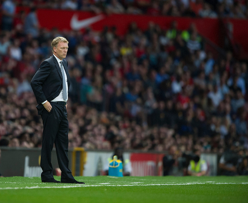 Manchester United's Manager David Moyes looks out over his new domain as the match kicks off<br /> <br /> Photo by Stephen White/CameraSport<br /> <br /> Football - Barclays Premiership - Manchester United v Chelsea - Monday 26th August 2013 - Old Trafford - Manchester<br /> <br /> &copy; CameraSport - 43 Linden Ave. Countesthorpe. Leicester. England. LE8 5PG - Tel: +44 (0) 116 277 4147 - admin@camerasport.com - www.camerasport.com
