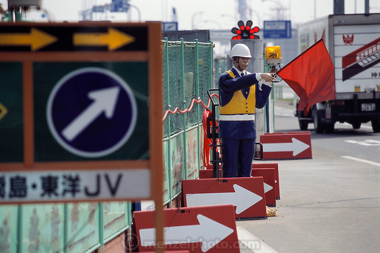 In Osaka, Japan, battery-powered robots?called Anzen Taro (Safety Sam) are used to control traffic. Robots like this one are becoming more common in Japan around government funded construction sites. These three dimensional robots can often be mistaken for real traffic guards.
