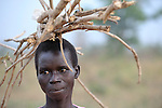 A woman in Yei, Southern Sudan, carries firewood home. NOTE: In July 2011, Southern Sudan became the independent country of South Sudan